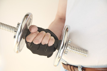 gloved hand with weight