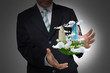 Business Man holding floating city