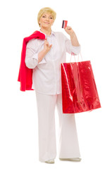 Senior woman with bag and credit card