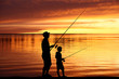 Fisherman silhouettes at sunrise