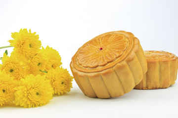 Moon cakes are decorated with yellow chrysanthemum.