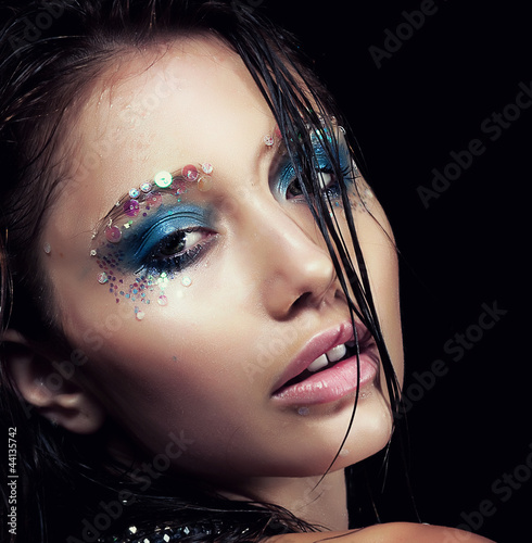 Young woman - bright makeup. Sensuality and beauty. Wet hair