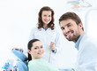 Dentist, his assistant and the patient
