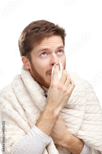 Sick young man holding wipes in his hands, isolated