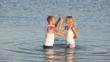Loving couple doing sensual dance in the lake