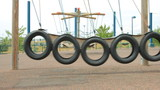 Swing from car wheels in the slow motion