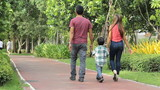 Asian Family Leaving Park After A Walk