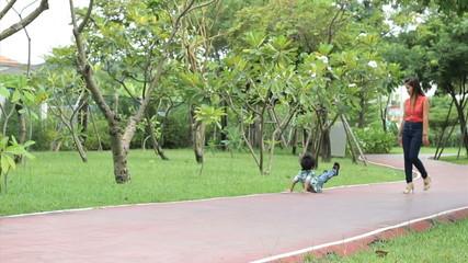Cute Asian Boy Doing A Crazy Walk In Park