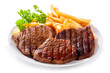 plate of grilled meat with frieis