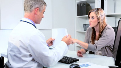 Female Business Executive with Male Medical Consultant