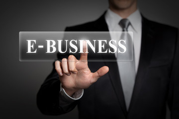 businessman pressing virtual button - E-business