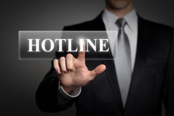 businessman pressing virtual button - hotline