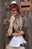 Red haired hipster girl posing poster