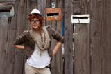 Hipster girl posing outdoors poster