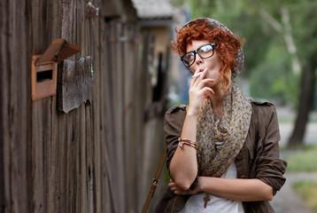Hipster girl smoking cigarette
