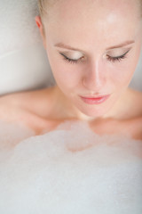 Bath woman enjoying bahub. Naturaly beautiful female relaxing