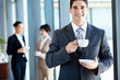 young businessman having coffee break in office