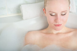 Bath woman enjoying bahub. Naturaly beautiful female relaxing