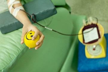 a donor donates blood at hemotransfusion station