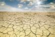 Leinwanddruck Bild - Land with dry and cracked ground. Desert