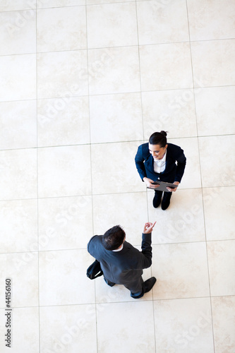 overhead view of businessman talking to businesswoman