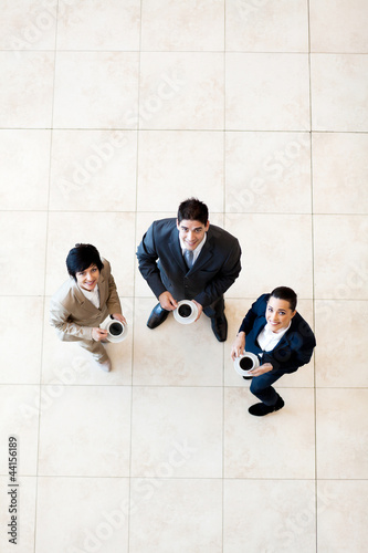 overhead view of colleagues having coffee break at work