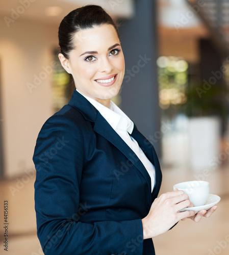 attractive modern businesswoman having coffee