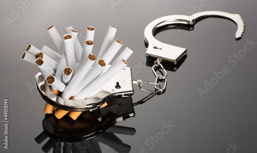 Cigarettes locked to handcuffs