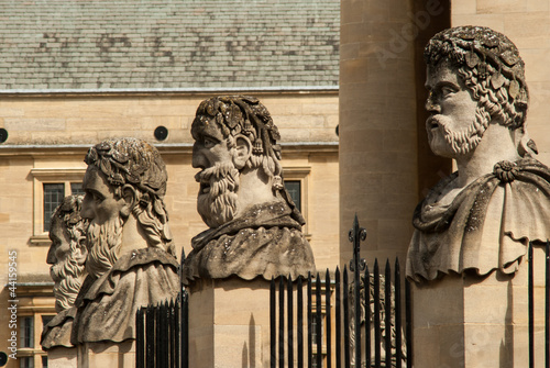 Four stone heads outside the Sheldonian theatre Oxford