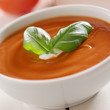 tomato soup with basil garnish.