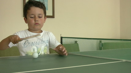Little boy learning ping pong