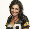 Beautiful happy smiling woman in American football top