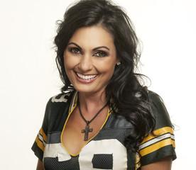 Beautiful happy smiling woman in American football top