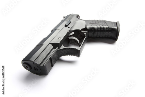 Black handgun on white