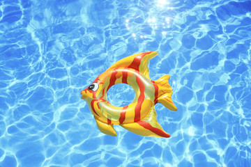 Fish shaped lifebuoy on swimming pool