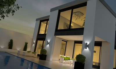 Villa mit Pool abends