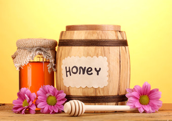 Sweet honey in barrel and jar with drizzler