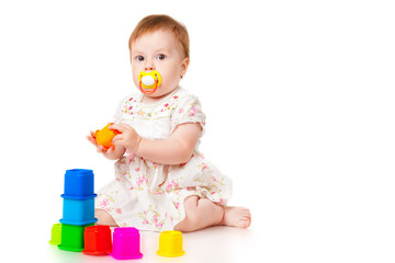 Little girl with a toys, isolated on white