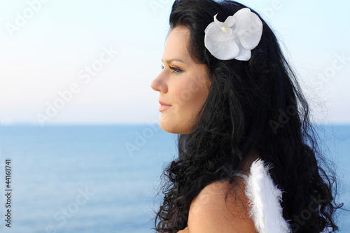 Portrait of beautiful young lady looking away