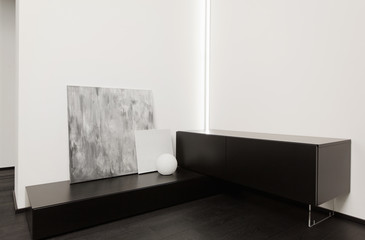 Fragment of modern minimalism style hall interior in black