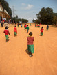 African Children go to church in the village Pomerini of  the Fr