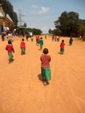 Fototapety African Children go to church in the village Pomerini of  the Fr