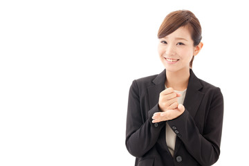a young businesswoman smiling on white background
