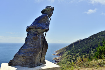 statue of a pilgrim at cape fisterra galicia spain