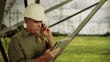 Electric Power Engineer on phone with electronic tablet