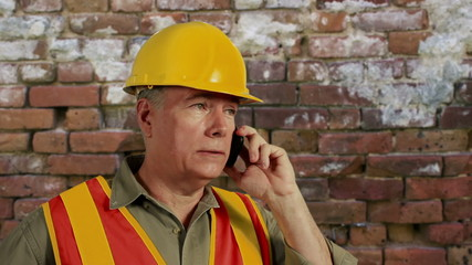 construction guy on a cell phone