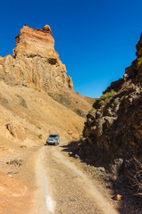 Car in Charyn Canyon near the Almaty city in Kazakhstan