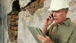 Construction engineer with cell phone and tablet