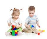little children playing together with colorful toy over white ba