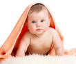 Adorable happy baby under a towel